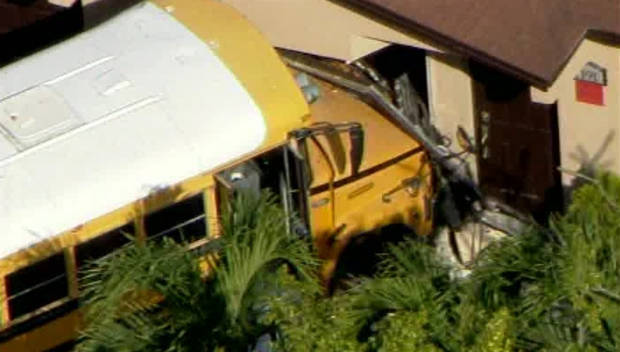 Video: Florida school bus packed with children slams into home