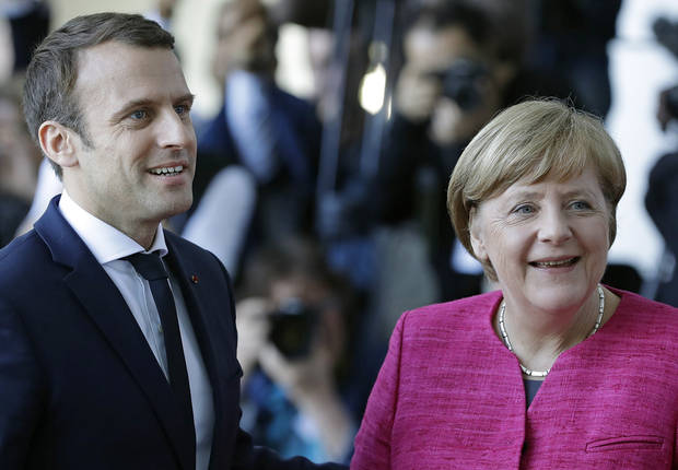 The Latest: Germany chancellor welcomes new French president