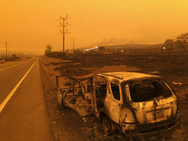 The Latest: Nurse fights flames escaping N. California fire