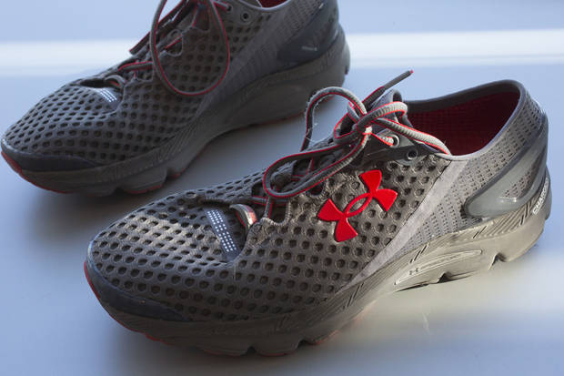 Under Armour, faltering, cuts its outlook and shares plunge