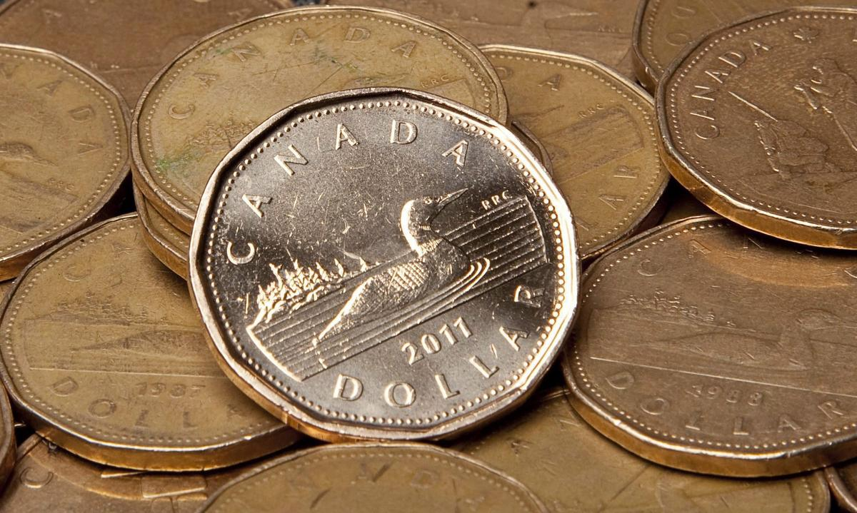 Toronto's main stock index down moderately, loonie slips