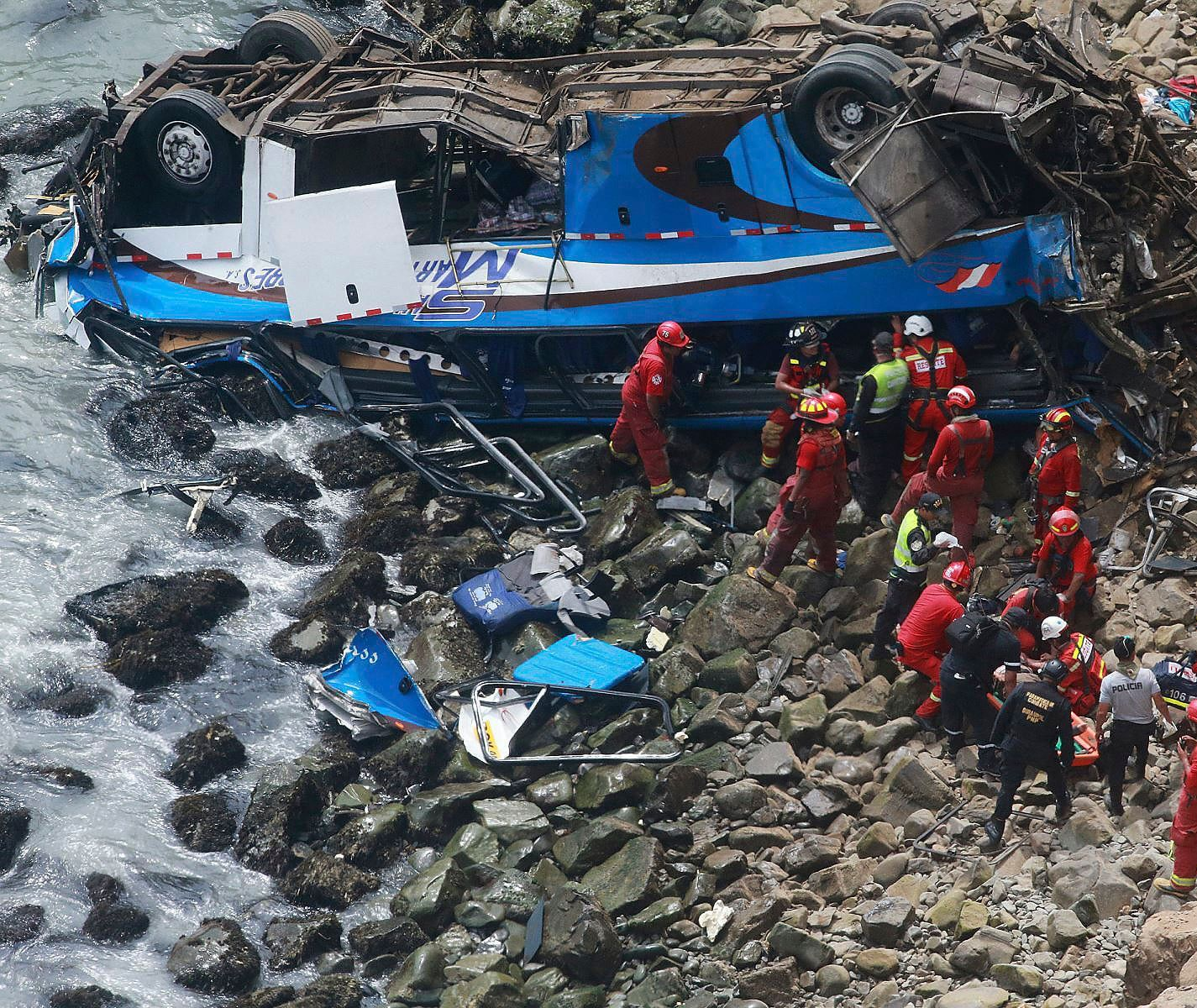 Peruvian rescue teams search for survivors of horrific bus crash on 'Devil's Curve'