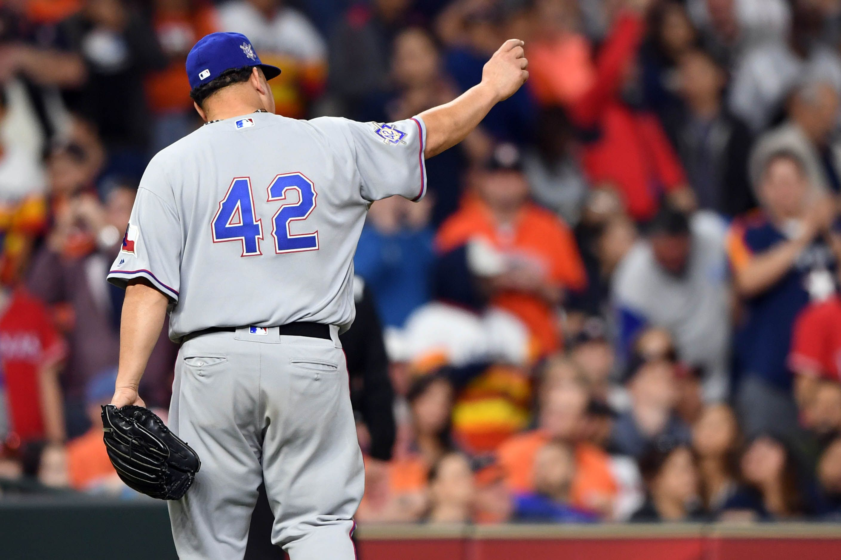 Bartolo Colon takes perfect game into 8th inning, Rangers beat Astros 3-1 in 10