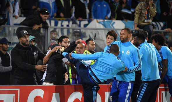 Patrice Evra SUSPENDED by Marseille after attacking fan