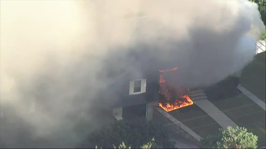 Homes burn after gas explosions north of Boston