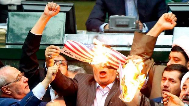 Watch: US flag set alight in Iran's parliament