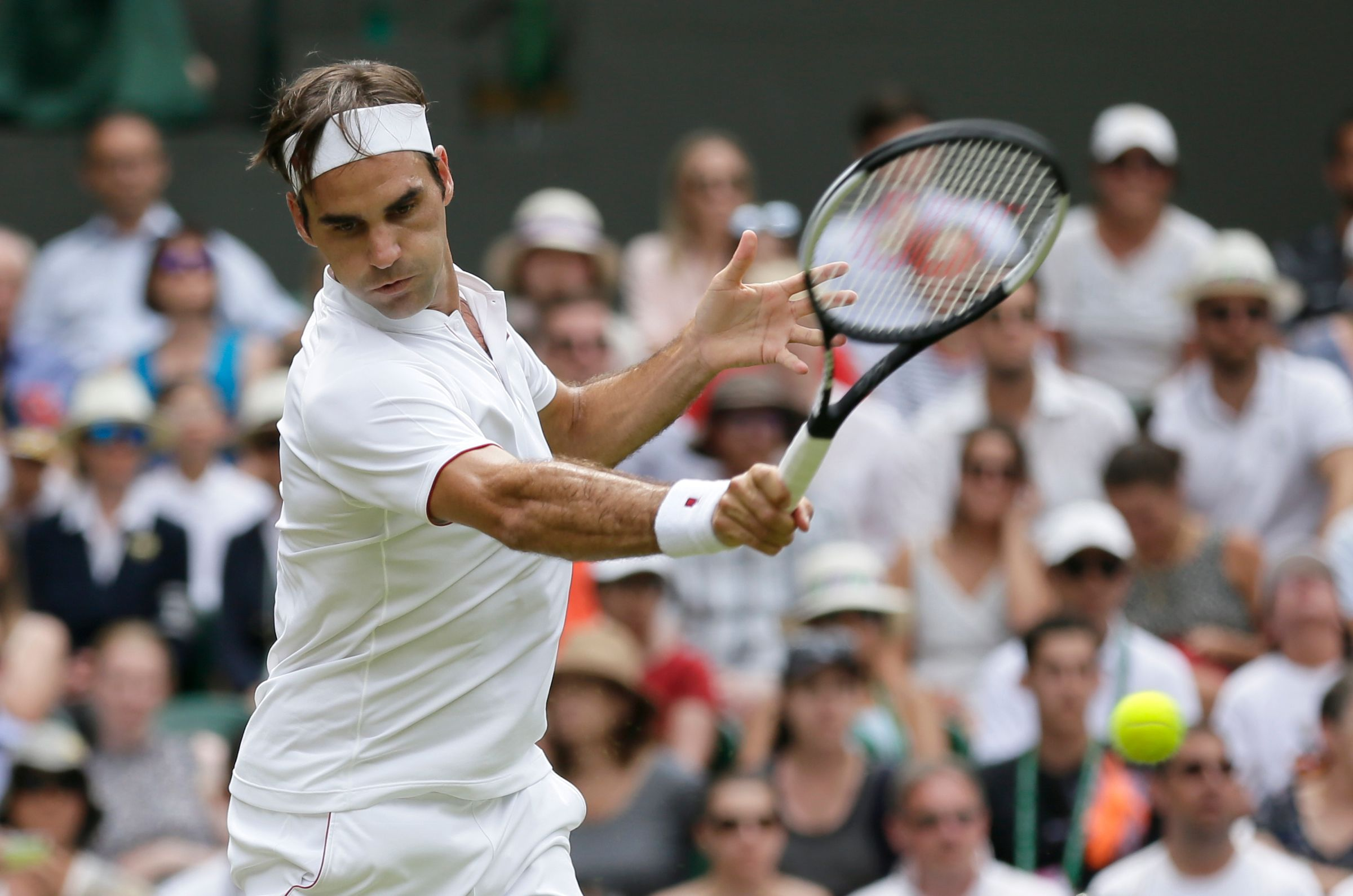 The Latest: Federer picks up where he left off at Wimbledon