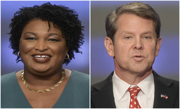 Georgia's Kemp says he's governor-elect, Abrams fights on
