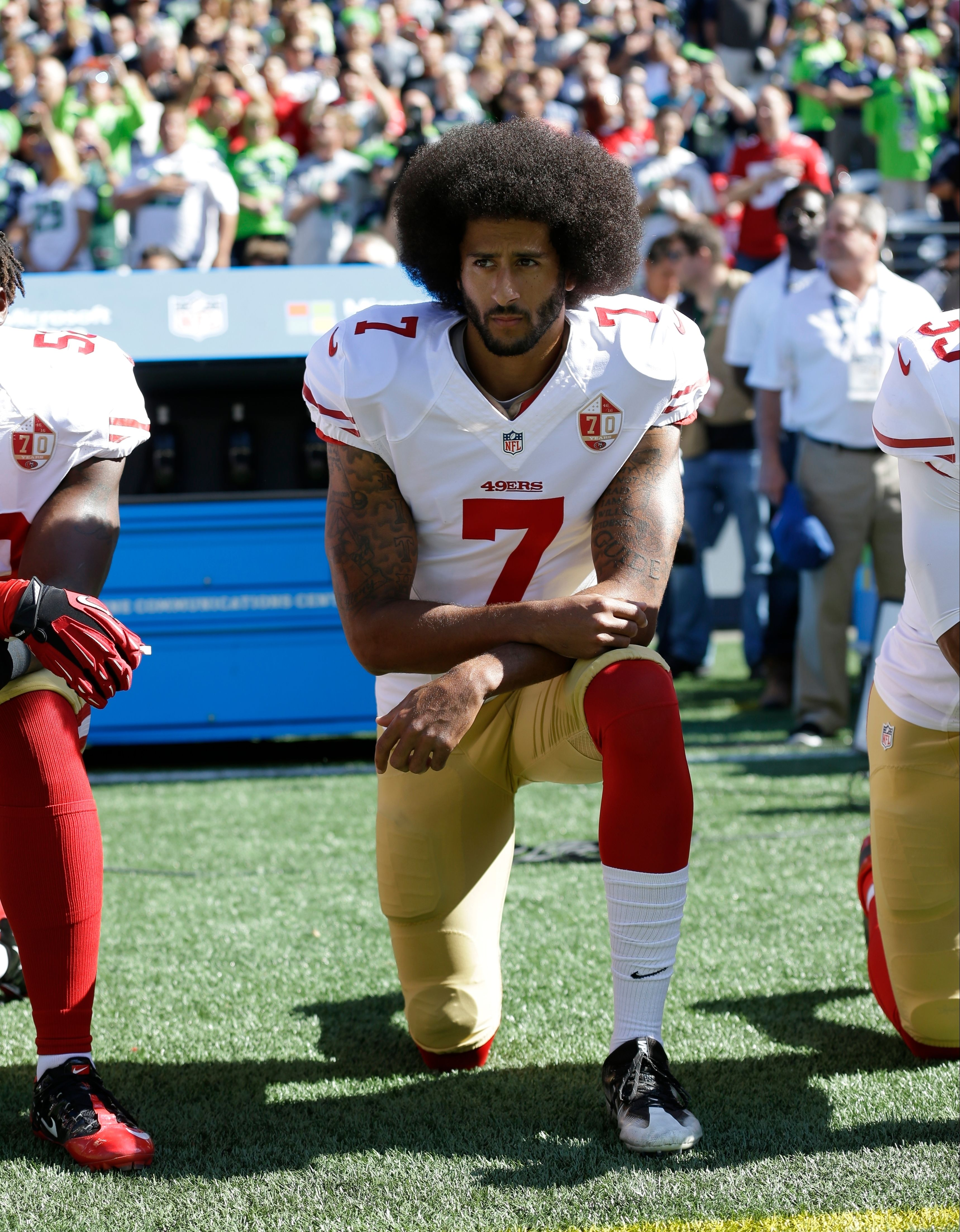 The Latest: Nike stock falls following Kaepernick's new deal
