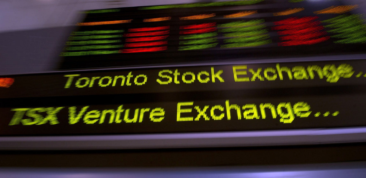 Aecon takeover deal helps TSX higher as the loonie slips