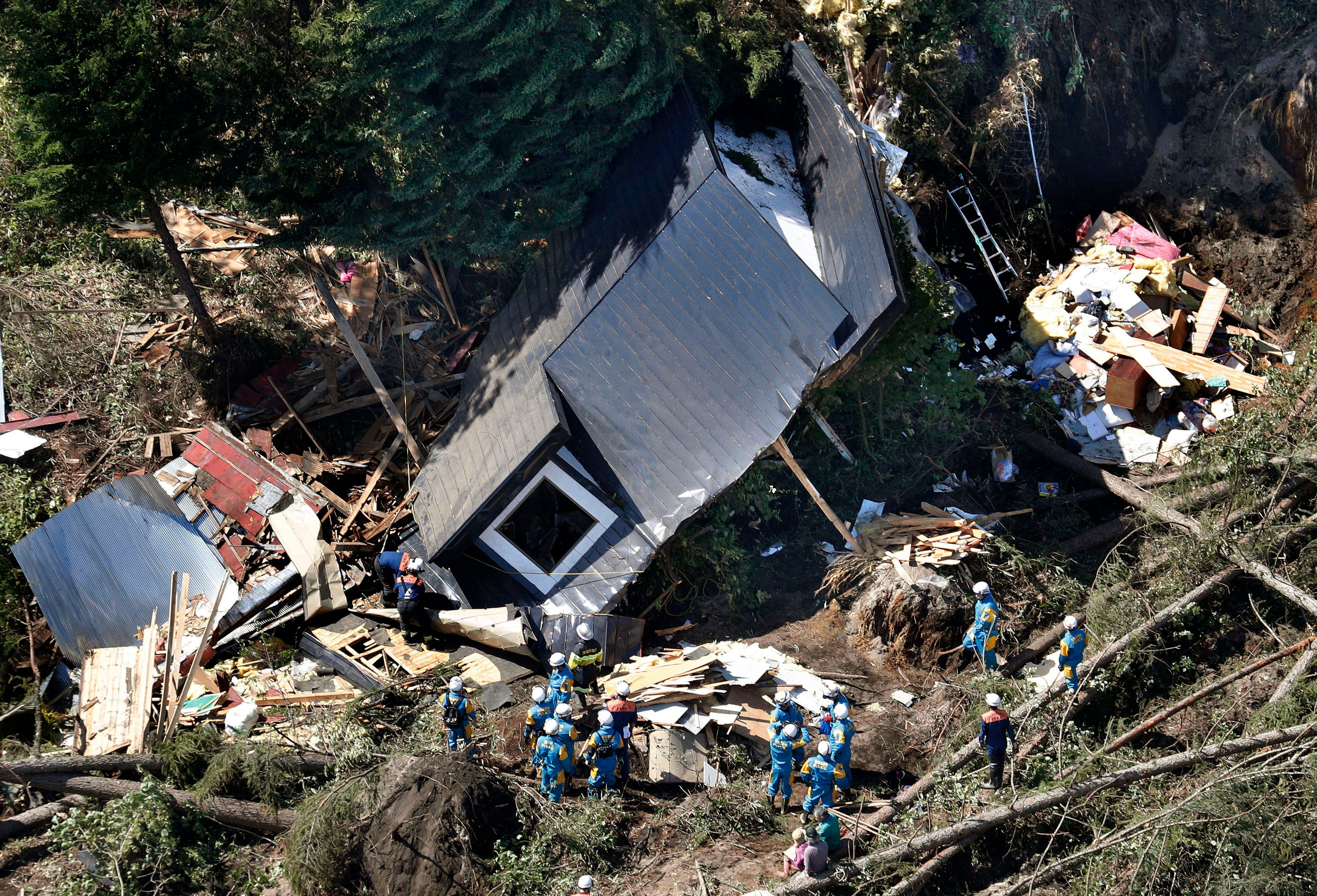 Powerful earthquake in northern Japan triggers landslides, blackout; at least two dead