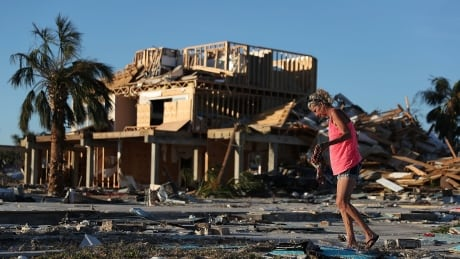 Rescuers comb rubble of Florida beach communities for Hurricane Michael survivors