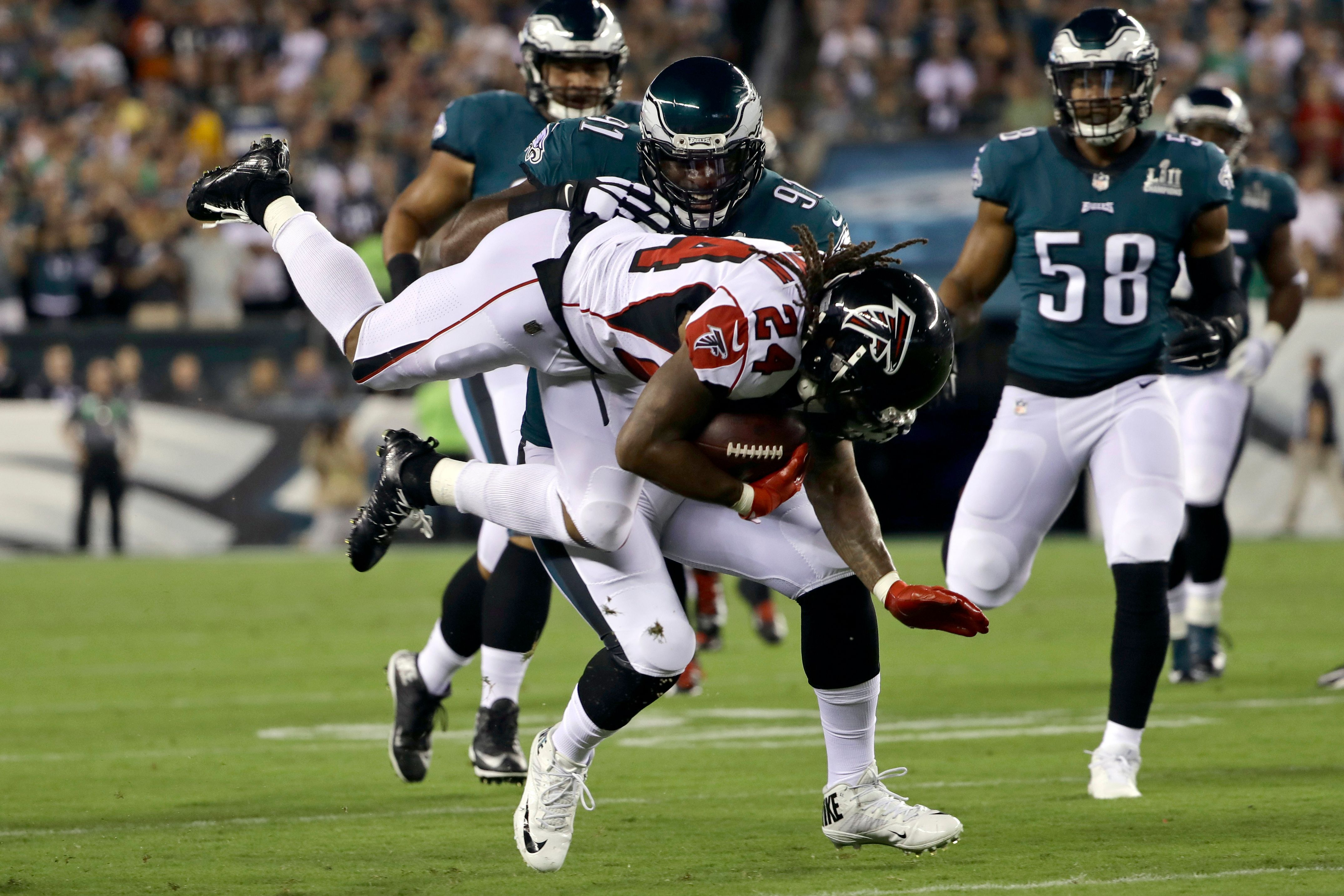 Foles shows off catching skills, Eagles beat Falcons 18-12