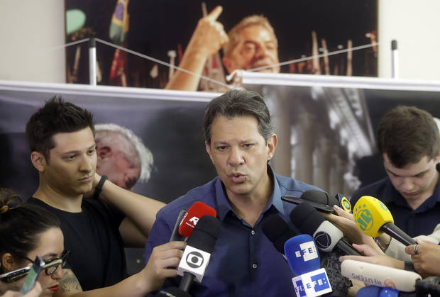Brazil candidate says far-right poll leader smears to rise