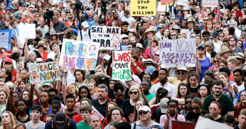 US students protest, plan more walk-outs for gun control