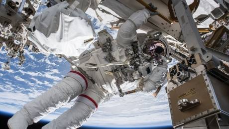 Astronauts performing spacewalk to set up TV cameras for arriving spacecraft