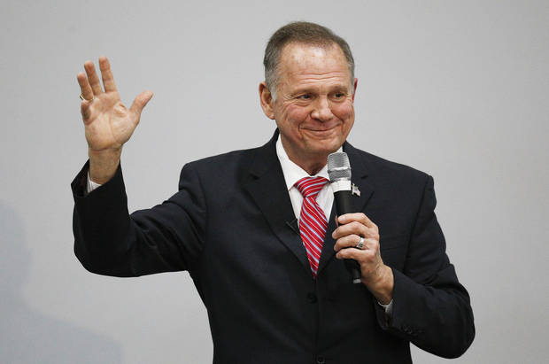 Amid calls to step down, Moore finds refuge with his base