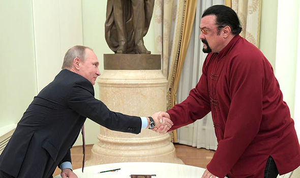 Putin hands Steven Seagal Russian passport in 'sign of improving relations with the US'