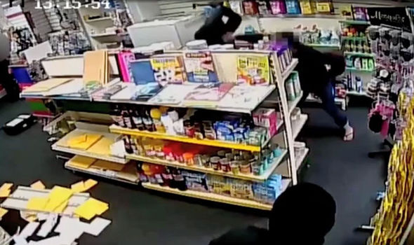 Shocking moment postal worked is beaten with a CROWBAR in violent armed robbery