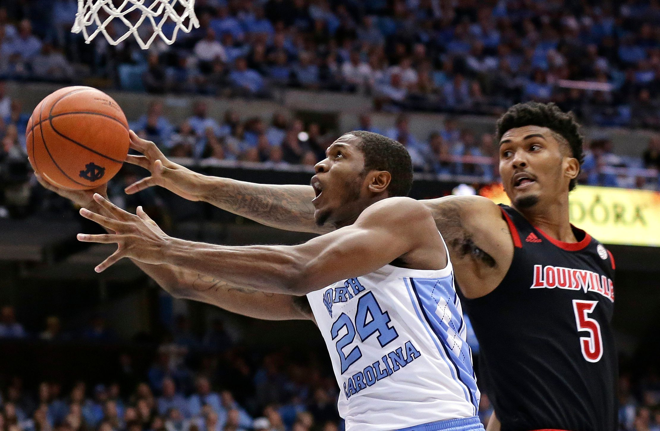 Louisville stuns No. 12 North Carolina 83-62 on the road