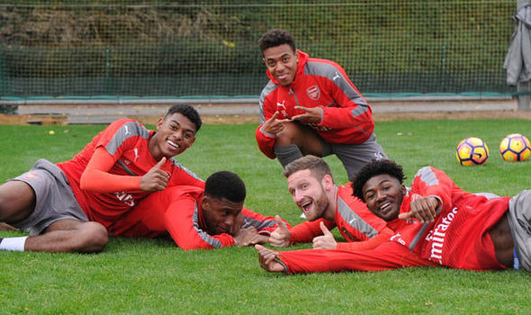 Arsenal training pictures: Santi Cazorla in action but where is Theo Walcott?