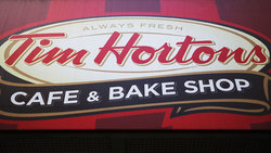 Tim Hortons franchisee seeks class-action lawsuit against parent company
