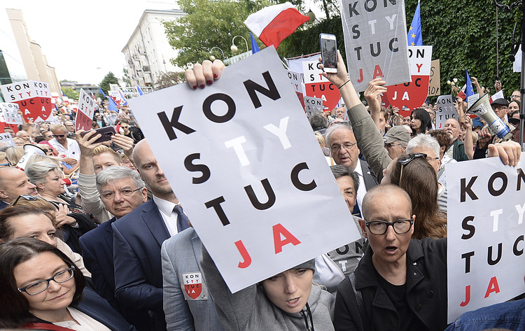 Poland's top judge shows up for work in defiance of controversial retirement law