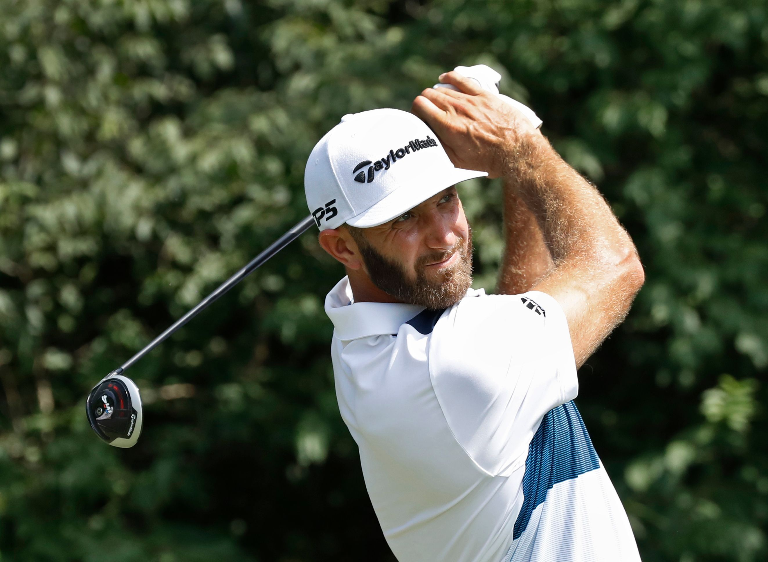 The Latest: Dustin Johnson opens with 67 at PGA Championship