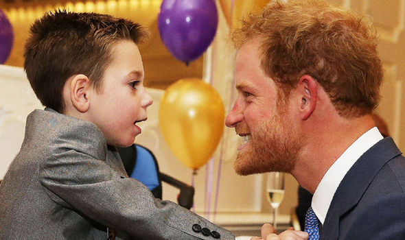 Terminally ill boy who can barely walk musters enough strength to hug Prince Harry