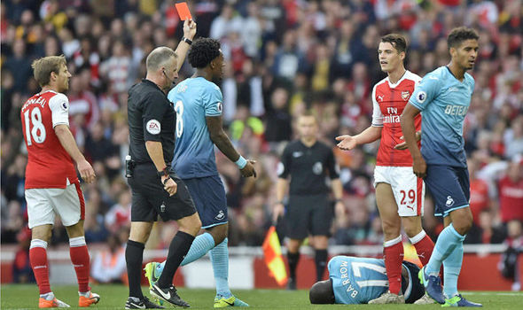 'He didn't mean to hurt anybody': Arsene Wenger defends Arsenal star after red card
