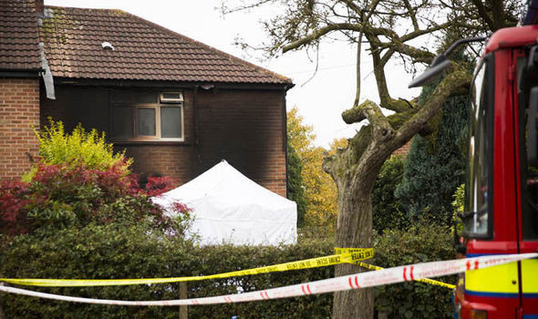 Eight-year-old boy dies in house blaze and mother seriously injured