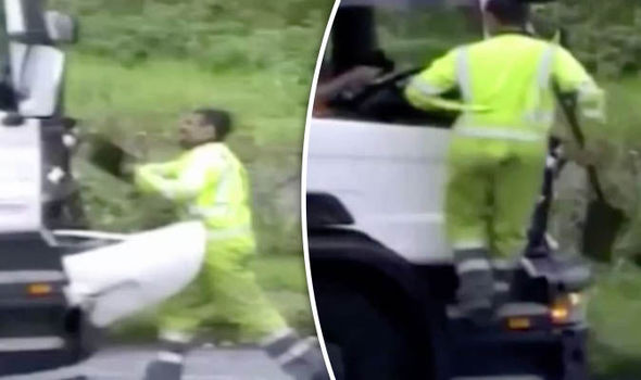 Terrifying moment road rage attacker smashes lorry with a spade