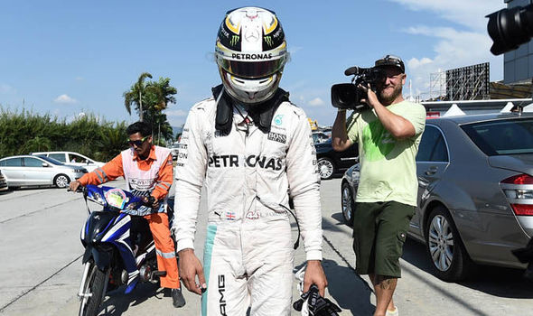 Malaysian Grand Prix: Hamilton's engine catches fire to lose ground on championship race