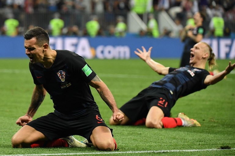 Croatia reaches first World Cup final as England pain goes on