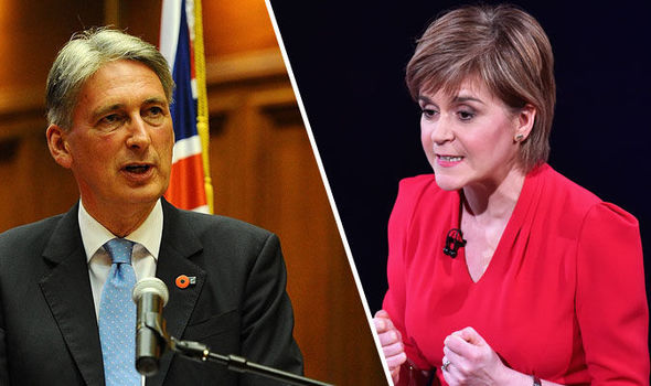 Philip Hammond warns Nicola Sturgeon to think 'VERY CAREFULLY' about Scottish tax hike