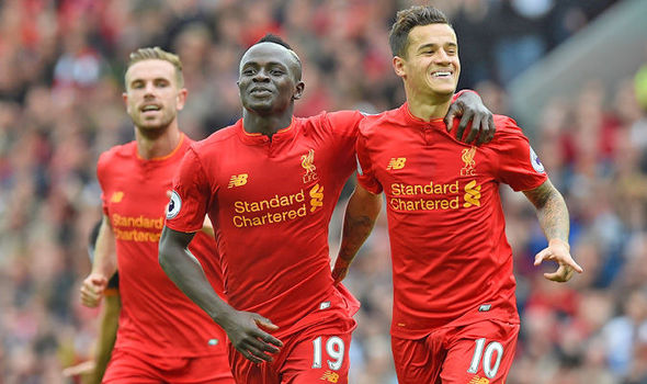 Liverpool 5 - Hull 1: Klopp's men maul 10-man Tigers to maintain impressive start