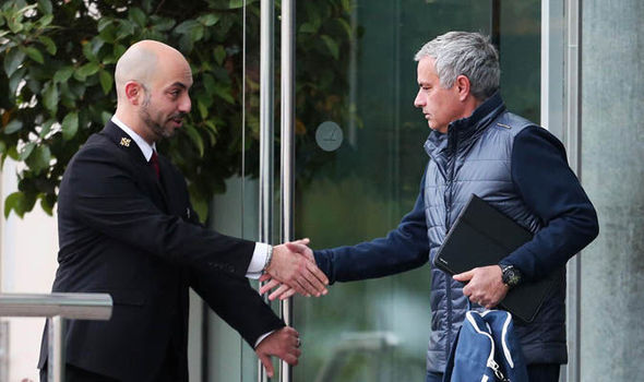 Spotted: Jose Mourinho looks stony-faced as Man Utd boss heads to work after Chelsea loss