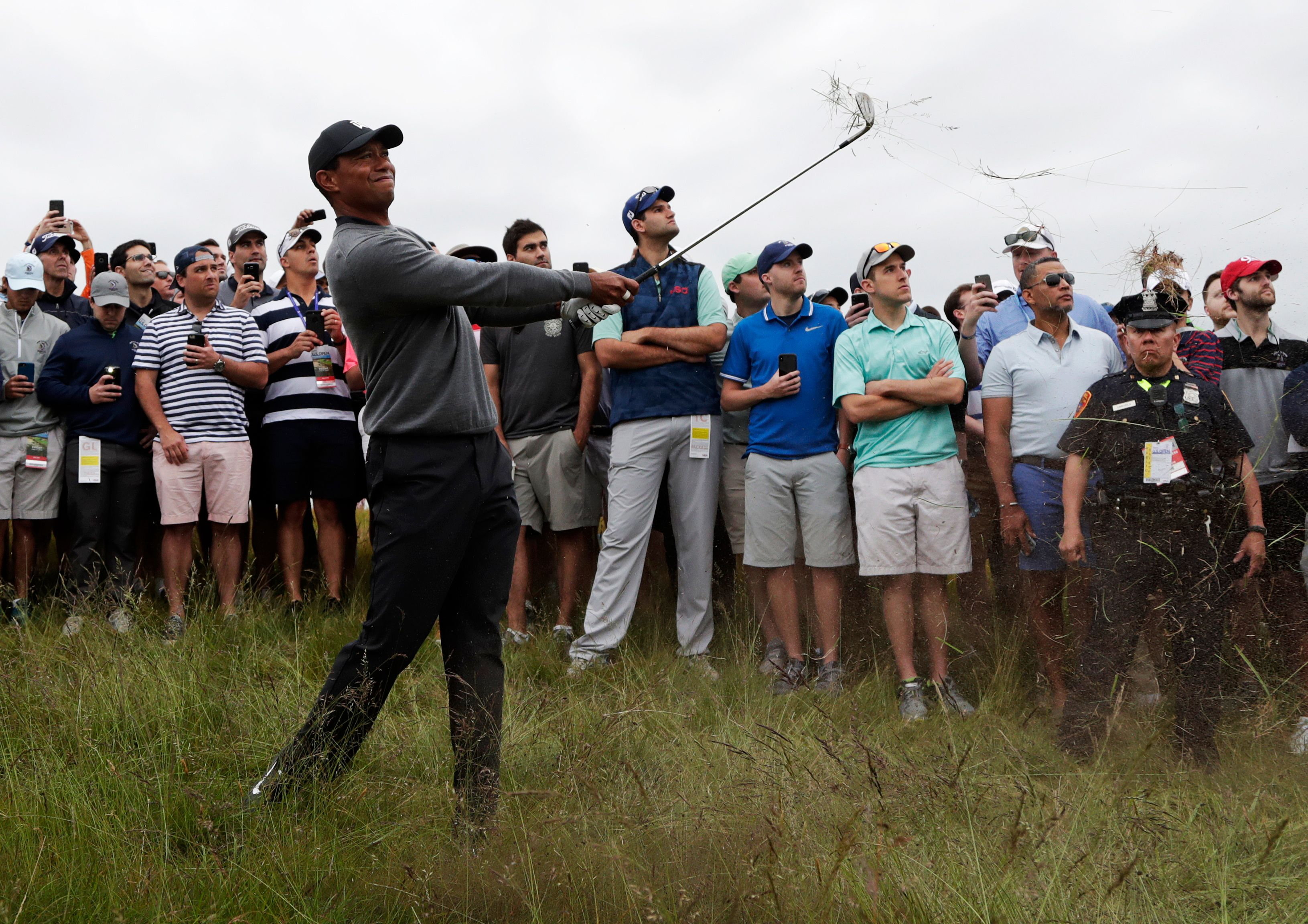 The Latest: Scoring improves in wet conditions at US Open