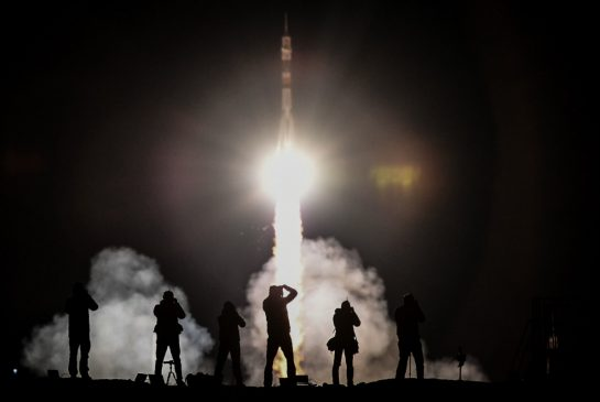 Soyuz capsule carrying 3 astronauts docks with space station