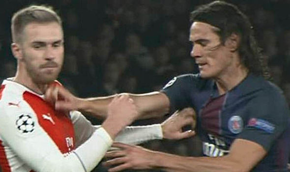 Spotted: Did Edinson Cavani punch Aaron Ramsey during Arsenal's stalemate with PSG?