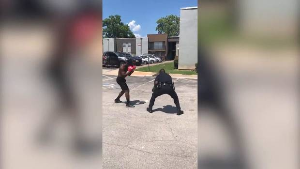 Police officer responded to a noise complaint. Then he put on boxing gloves, video shows