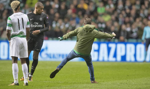 Celtic fan ran onto pitch and tried to KICK Kylian Mbappe during PSG thrashing