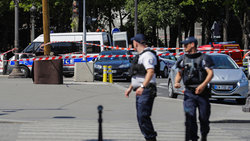 Paris police cordon off part of iconic Champs-Elysees after car reportedly crashes into police van
