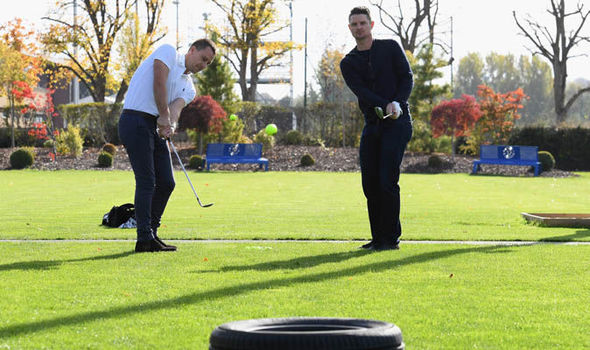 Chelsea skipper John Terry gives Olympic gold medallist Justin Rose a tour of Cobham