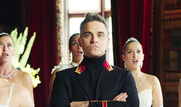 How has 'RACIST' Robbie Williams made the Russians SO furious with outrageous new video?