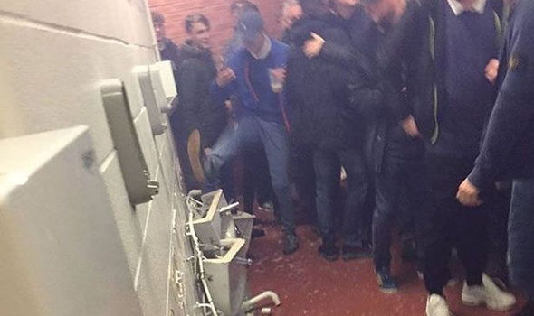 Watch this shocking footage of Manchester City fans smashing up toilets at Old Trafford