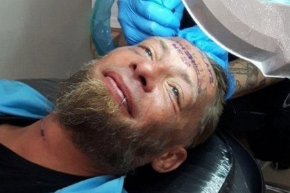 British stags 'paid homeless man to tattoo forehead'