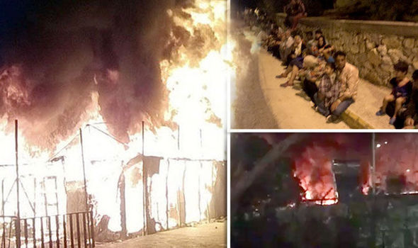 BREAKING NEWS: Thousands of migrants flee Greek refugee camp 'after setting fire to it'