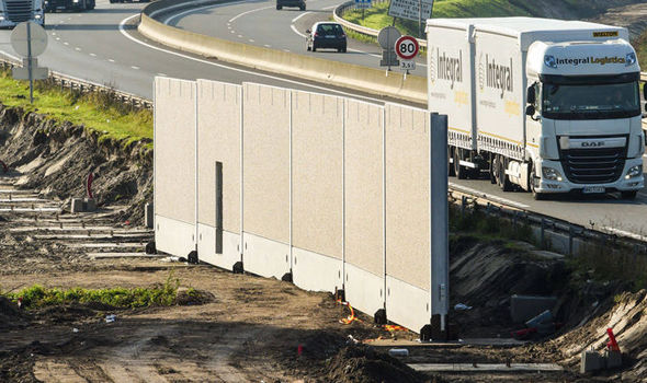 PICTURED: Construction begins on the £2.5m British funded 'Great Wall of Calais'