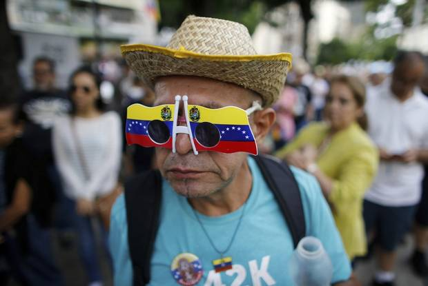 The Latest: Venezuelans turn out for anti-govt vote in Spain